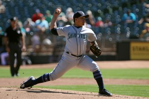 Seattle Mariners pitcher Erasmo Ramirez (31) pitches in the first inning as the Seattle Mariners take on the Oakland Athletics at the Oakland Coliseum on Wednesday, September 27, 2017.