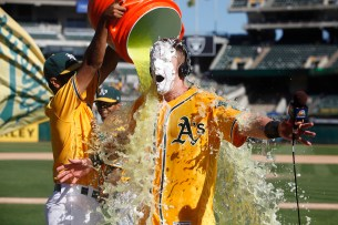 Oakland Athletics left fielder Mark Canha (20) gets gatorade dumped on him after their game against the Seattle Mariners at the Oakland Coliseum on Wednesday, September 27, 2017. Athletics won 6-5.