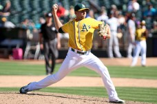 Oakland Athletics relief pitcher Blake Treinen (39) pitches in the ninth inning as the Seattle Mariners take on the Oakland Athletics at the Oakland Coliseum on Wednesday, September 27, 2017.