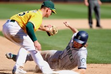 Oakland Athletics third baseman Matt Chapman (26) attempts to tag Seattle Mariners infielder Gordon Beckham (6) out at third base in the ninth inning as the Seattle Mariners take on the Oakland Athletics at the Oakland Coliseum on Wednesday, September 27, 2017. Athletics won 6-5.
