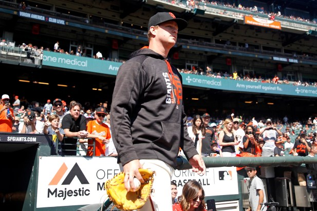 San Francisco Giants pitcher Matt Cain (18) leaves the dugout to warm up before their game against the San Diego Padres at AT&T Park on Saturday, September 30, 2017.