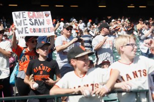 Fans cheer on San Francisco Giants pitcher Matt Cain (18) as he leaves the dugout for a pregame warmup as the San Diego Padres take on the San Francisco Giants at AT&T Park on Saturday, September 30, 2017.