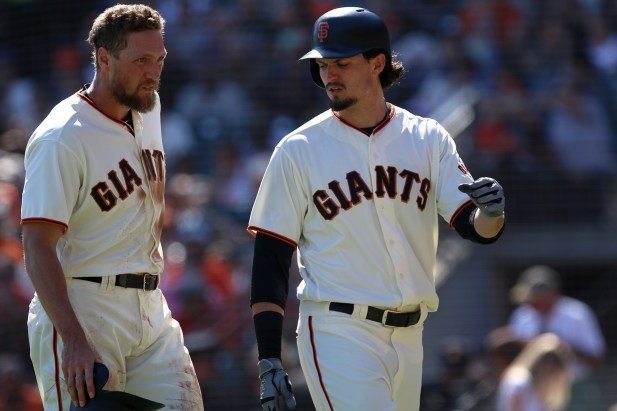 San Francisco Giants right fielder Hunter Pence (8) and San Francisco Giants left fielder Jarrett Parker (6) walk back to the dugout after the second inning as the San Diego Padres take on the San Francisco Giants at AT&T Park on Saturday, September 30, 2017.