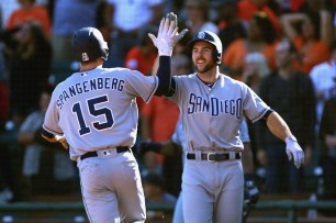 San Diego Padres left fielder Cory Spangenberg (15) celebrates after scoring a run as the San Diego Padres take on the San Francisco Giants at AT&T Park on Saturday, September 30, 2017. Giants lost 2-3.