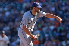 San Diego Padres pitcher Brad Hand (52) pitches in the ninth inning as the San Diego Padres take on the San Francisco Giants at AT&T Park on Saturday, September 30, 2017.
