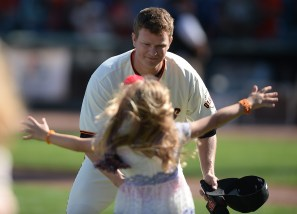 San Francisco Giants starting pitcher Matt Cain (18), leans down as his daughter Hartley, 6, jumps into his arms during a farewell ceremony after they beat the San Diego Padres 5-4 at AT&T Park in San Francisco, Calif., on Sunday, October 1, 2017.