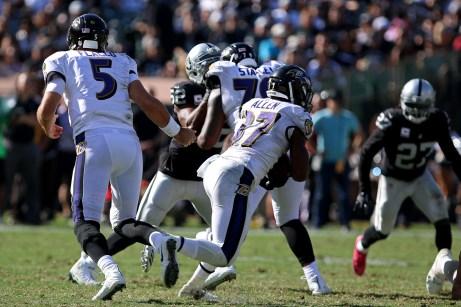 Baltimore Ravens quarterback Joe Flacco (5) passes the ball to Baltimore Ravens cornerback Brandon Boykin (35) as the Baltimore Ravens take on the Oakland Raiders at the Oakland Coliseum on Sunday, October 8, 2017. The Ravens won 30-17.