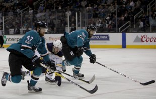 San Jose Sharks Joakim Ryan (47) and Brent Burns (88) race Buffalo Sabres Zemgus Girgensons (28) to the puck in the first period as the Buffalo Sabres take on the San Jose Sharks at the SAP Center in San Jose, Calif., on Thursday, October 12, 2017.
