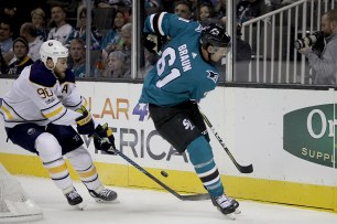 San Jose Sharks Justin Braun (61) passes the puck in the first period as the Buffalo Sabres take on the San Jose Sharks at the SAP Center in San Jose, Calif., on Thursday, October 12, 2017.