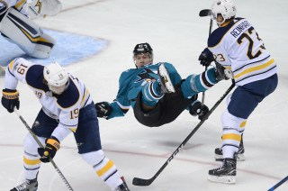 San Jose Sharks Joonas Donskoi (27) is upended by Buffalo Sabres Sam Reinhart (23) in the second period as the Buffalo Sabres take on the San Jose Sharks at the SAP Center in San Jose, Calif., on Thursday, October 12, 2017.