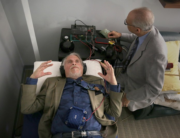 Psychatrist and pain specialist Dr. Michael H Moskowitz, MD (right), uses sound therapy on his patient , Bobby Ocean (left), on Thursday, February 22, 2018, in San Rafael, Calif.