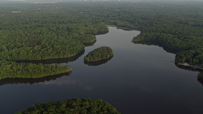 5K Aerial Video Flying By Burke Lake, Tree-covered Shores