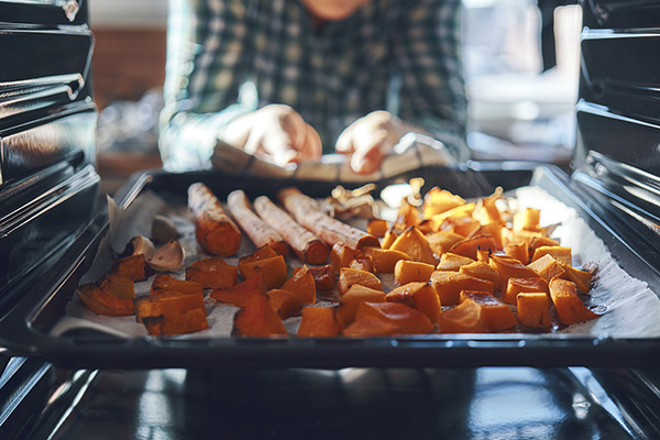 Roasting a batch of sweet potatoes