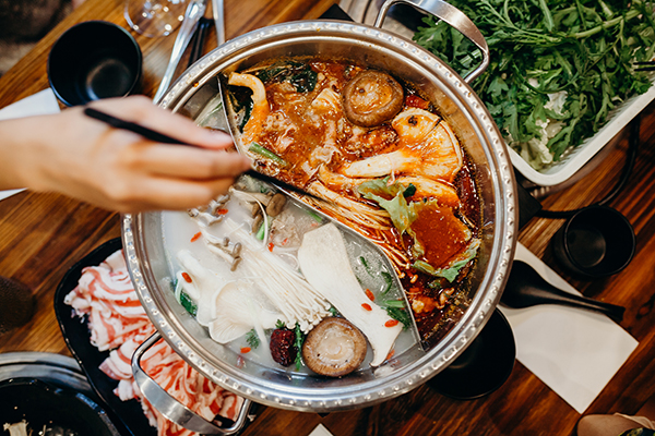 Hot pot meal on a table.