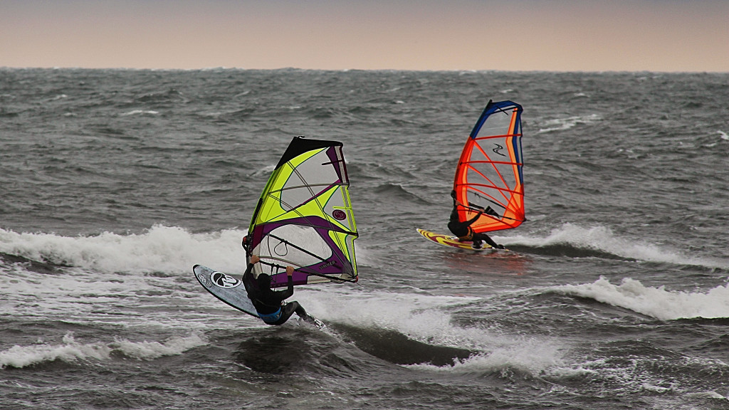 Photo of two windsurfers.