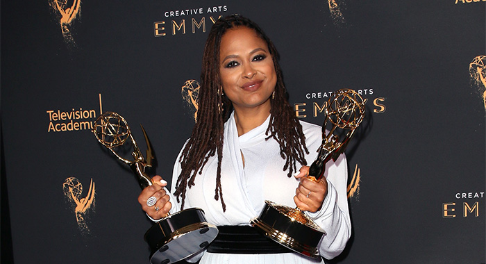 """LOS ANGELES, CA - SEPTEMBER 09: Ava Duvernay poses in the press room with the awards for outstanding documentary or nonfiction special and outstanding writing for nonfiction programming for """"13th"""" during the 2017 Creative Arts Emmy Awards at Microsoft Theater on September 9, 2017 in Los Angeles, California. (Photo by David Livingston/Getty Images)"""