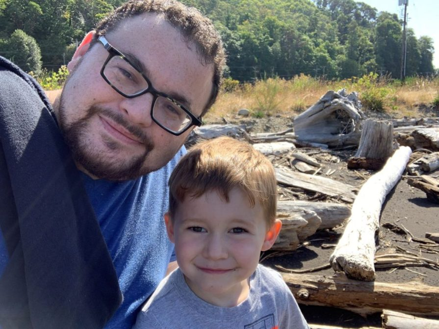 man and son on a river bank
