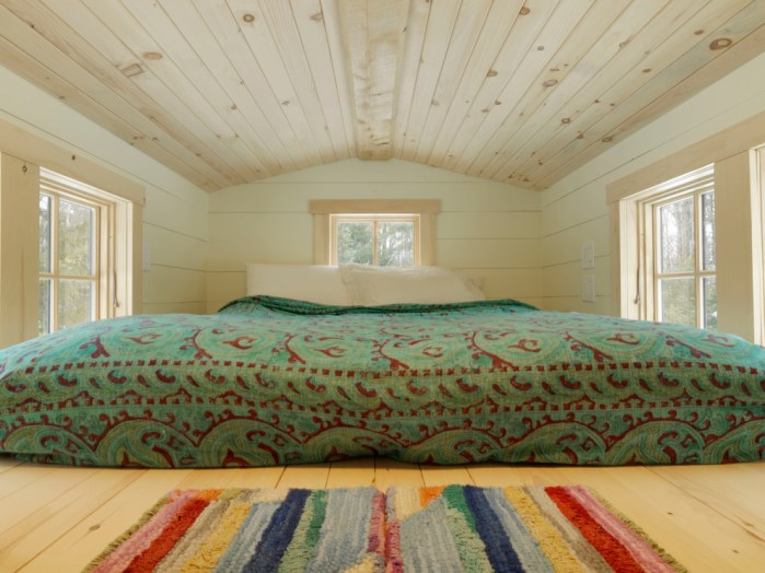 The bedroom in the attic Tiny House