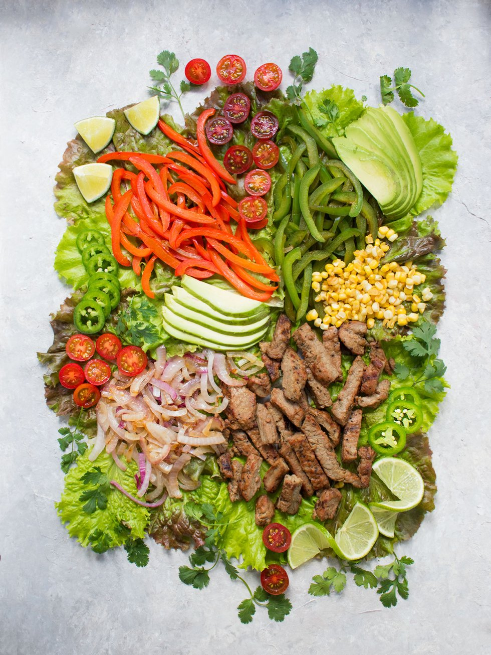 Ingredients for the Beef Fajita Salad spread out on a board. Recipe at SoupAddict.com