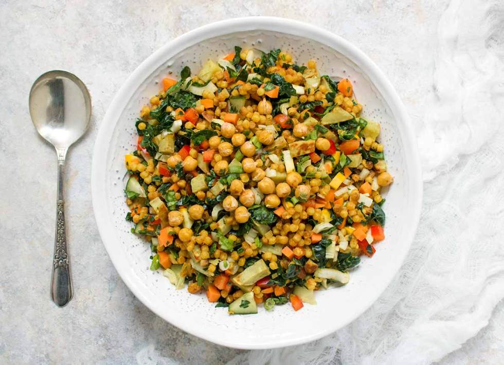 Fall Israeli Couscous Salad, served family-style, in a bowl. Recipe at SoupAddict.com