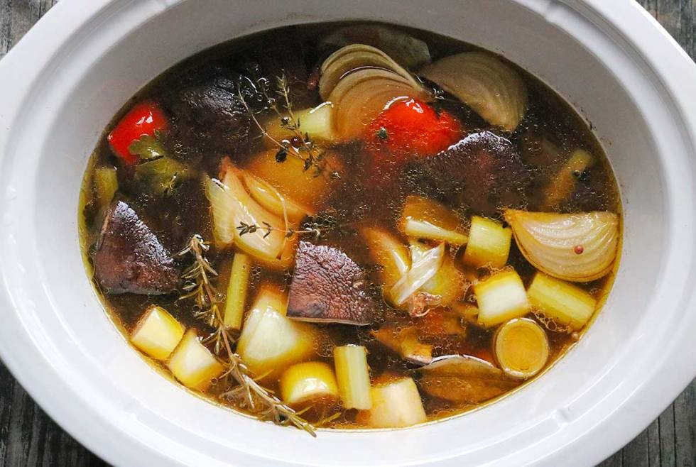 The Best Slow Cooker Roasted Vegetable Broth from SoupAddict.com