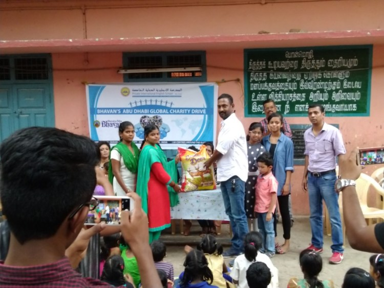 Kiran Handing over the Rice Bag