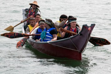 Members of the One People Canoe Society paddle during the last leg of their trip on Wednesday, June 8, 2016, near Juneau, Alaska. The group began a trip to Juneau from Angoon on June 2. Their landing in Douglas is the unofficial beginning of Celebration. (Photo by Rashah McChesney/KTOO)