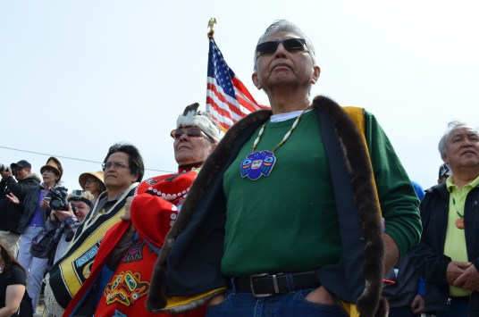 Before the canoes can come ashore, they must get permission from the Auke Kwan Tlingits of Juneau. Fran Houston of the Auke Kwan was joined by Paul Marks of the Douglas Indian Association to carry out the tradition. (Photo by Emily Kwong/KCAW)