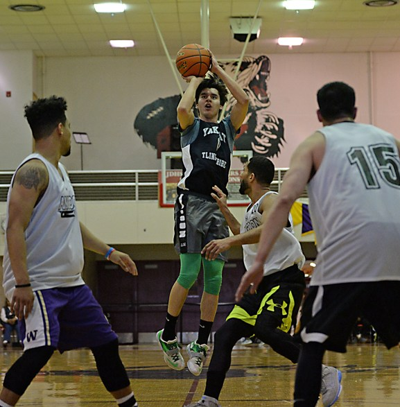 Yakutat's Josh James (0) shoots against Angoon during their elimination game in the B-Bracket of the Juneau Lions Club 71st Annual Gold Medal Basketball Tournament at Juneau-Douglas High School on Tuesday. Angoon won 84-76. (Photo courtesy Klas Stolpe)