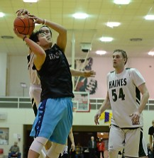 Hydaburg's Donald Edenshaw has his shot blocked by Haines' Ryan Harms as Ben Egolf (54) looks on in B-bracket action at the Juneau Lions Club 71st Annual Gold Medal Basketball Tournament on Sunday, March 19, 2017, at JDHS. Haines won 86-71. (Photo courtesy Klas Stolpe)