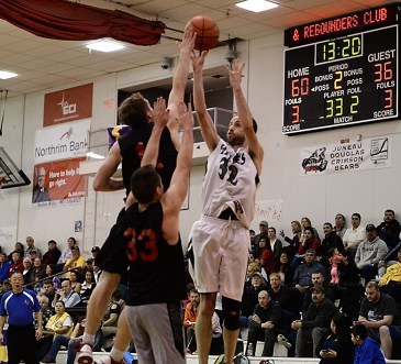 Haines' Tyler Healey (32) shoots over Wrangell's their B-Bracket quarterfinal in the Juneau-Lions Club 71st Annual Gold Medal Basketball Tournament at Juneau-Douglas High School on Monday. (Photo courtesy Klas Stolpe)
