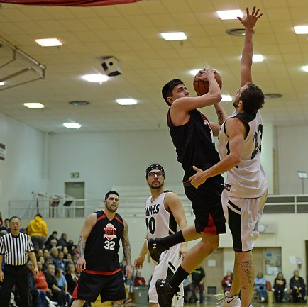 Action during the B-Bracket championship of the Juneau Lions Club 71st Annual Gold Medal Basketball Tournament at Juneau-Douglas High School on Saturday. Haines topped Hoonah 79-73. (Photo courtesy Klas Stolpe)
