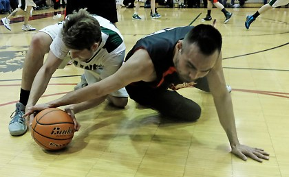Haines' Orion Falvey and Hoonah's David Lindstrom go for a loose ball during the B-Bracket championship of the Juneau Lions Club 71st Annual Gold Medal Basketball Tournament at Juneau-Douglas High School on Saturday. Haines won 79-73. (Photo courtesy Klas Stolpe)