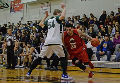 Hoonah's Jonathan Torres (32) dribbles around Haines' Ben Egolf (54) during their B-Bracket semifinal in the Juneau Lions Club 71st Annual Gold Medal Basketball Tournament at Juneau-Douglas High School on Thursday. Haines won 77-63. (Photo courtesy Klas Stolpe)