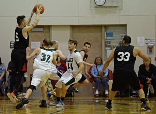 Hoonah's Brian Koening makes a jump pass against Haines during the B-Bracket championship of the Juneau Lions Club 71st Annual Gold Medal Basketball Tournament at Juneau-Douglas High School on Saturday. Haines won 79-73. (Photo courtesy Klas Stolpe)
