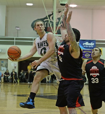 Haines' Kyle Fossman (42) shoots against Hoonah's Jon Torres (32) during the B-Bracket championship of the Juneau Lions Club 71st Annual Gold Medal Basketball Tournament at Juneau-Douglas High School on Saturday. Haines won 79-73. (Photo courtesy Klas Stolpe)