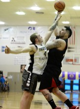 Hoonah's Jonathan Torres scores over Yakutat's Jake Taylor (4) during Hoonah's 69-63 win in a B-bracket game at the Juneau Lions Club 71st Annual Gold Medal Basketball Tournament on Sunday, March 19. (Photo courtesy Klas Stolpe)