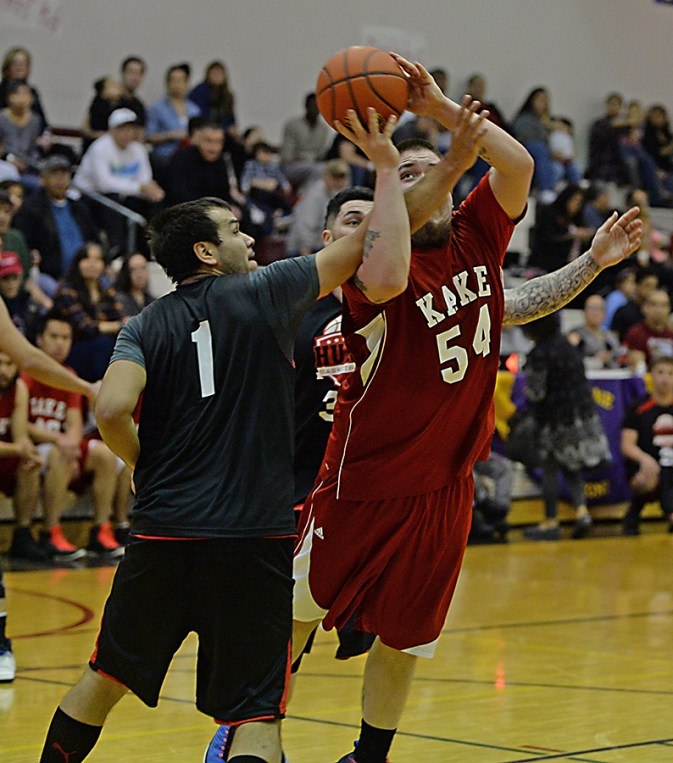 Kake's Deion Jackson (54) is fouled by Hoonah's George Fisher (1) in their B-Bracket game of the Juneau-Lions Club 71st Annual Gold Medal Basketball Tournament at Juneau-Douglas High School on Monday. Hoonah won 61-57. (Photo courtesy Klas Stolpe)
