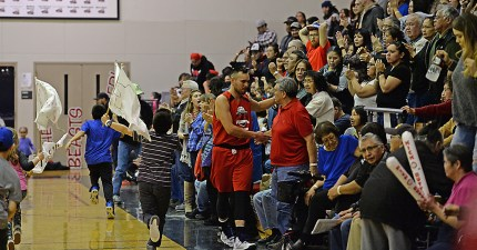 Hoonah's DJ Lindstrom celebrates with fans after their B-Bracket elimination game agasint Wrangell in the Juneau Lions Club 71st Annual Gold Medal Basketball Tournament at Juneau-Douglas High School on Friday. Hoonah won 85-77. (Photo courtesy Klas Stolpe)