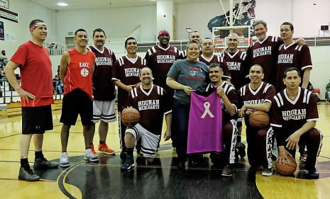 Breast-cancer survivor Cristina Dybdahl poses with her pink jersey, presented by the Hoonah Masters team, prior to play on Monday at the Juneau Lions Club 71st Annual Gold Medal Basketball Tournament at Juneau-Douglas High School. (Photo courtesy Klas Stolpe)