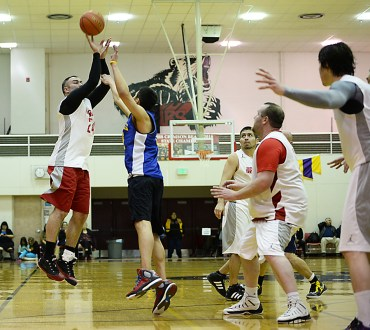Hoonah's Travis Dybdahl shoots over James Gang's Billy Ehlers during their C-Bracket elimination game at the Juneau Lions Club 71st Annual Gold Medal Basketball Tournament at Juneau-Douglas High School on Thursday. James Gang won 71-50. (Photo courtesy Klas Stolpe)