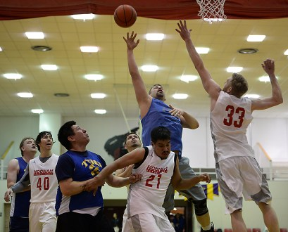 James Gang's Ray Zimmer shoots against Hoonah's Lucas Johnson (21) and Mike Schneeberger (33) during their C-Bracket elimination game in the Juneau Lions Club 71st Annual Gold Medal Basketball Tournament at Juneau-Douglas High School on Thursday. James Gang won 71-50. (Photo courtesy Klas Stolpe)
