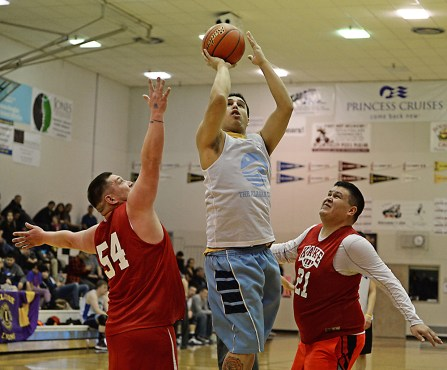 James Gang forward Levi Hotch scores over Kake's Jess Ross (54) and Brandon Jackson (21) during their C-bracket elimination game at the Juneau Lions Club 71st Annual Gold Medal Basketball Tournament at Juneau-Douglas High School on Tuesday. James Gang won 88-52. (Photo courtesy Klas Stolpe)