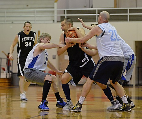 Yakutat's Ahpa Porter protects the ball from James Gang's trapping defense in a C-Bracket elimination game in the Juneau Lions Club 71st Annual Gold Medal Basketball Tournament at Juneau-Douglas High School on Wednesday. James Gang won 70-62. (Photo courtesy Klas Stolpe)