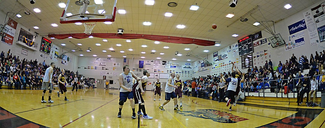 Klukwan's Stuart Dewitt (40) shoots over James Gang's Al Tagaban (21) during C-Bracket championship of the Juneau Lions Club 71st Annual Gold Medal Basketball Tournament at Juneau-Douglas High School on Saturday. Klukwan won 107-97. (Photo courtesy Klas Stolpe)