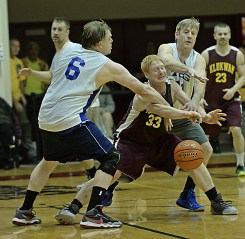 Klukwan's Jesse McGraw (33) is fouled by James Gang's Sean Joslyn (6) and Doug Drazkowski (11) during C-Bracket championship of the Juneau Lions Club 71st Annual Gold Medal Basketball Tournament at Juneau-Douglas High School on Saturday. Klukwan won 107-97. (Photo courtesy Klas Stolpe)
