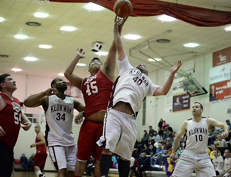 Kake's Burt Jackson (45) and Klukwan's Stuart DeWitt (40) battle for a rebound during Klukwan's 85-54 win in the opening C Bracket game of the Juneau Lions Club 71st Annual Gold Medal Basketball Tournament at JDHS on Sunday, March 19, 2017. Kake's Jess Ross (54) and Klukwan's Jackie Wyatt (34) and Scott Forbes (10) look on. (Photo courtesy Klas Stolpe)