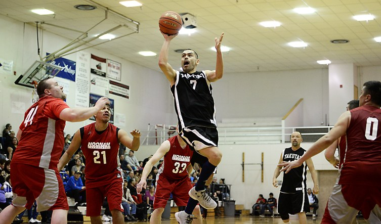 Yakutat's Ahpa Porter (7) scores against Hoonah in a C Bracket game of the Juneau Lions Club 71st Annual Gold Medal Basketball Tournament at JDHS on Sunday, March 19, 2017. Yakutat won 62-59. (Photo courtesy Klas Stolpe)
