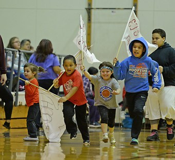 Fans with flags during the Women's Bracket championship of the Juneau Lions Club 71st Annual Gold Medal Basketball Tournament at Juneau-Douglas High School on Saturday. (Photo courtesy Klas Stolpe)