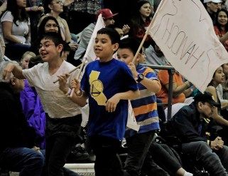 Fans carry flags prior to the start of a game at the Juneau Lions Club 71st Annual Gold Medal Basketball Tournament on Saturday. (Photo courtesy Klas Stolpe)